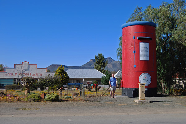 The giant post box dwarfs its surroundings