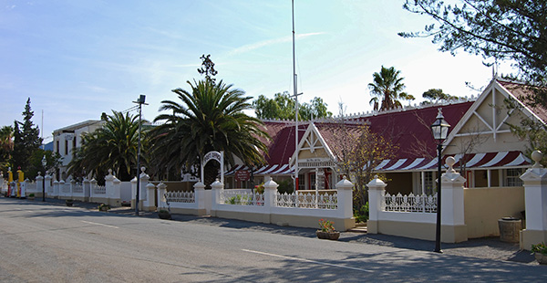 Matjiesfontein village with all its colonial era buildings lining the road facing the railway line