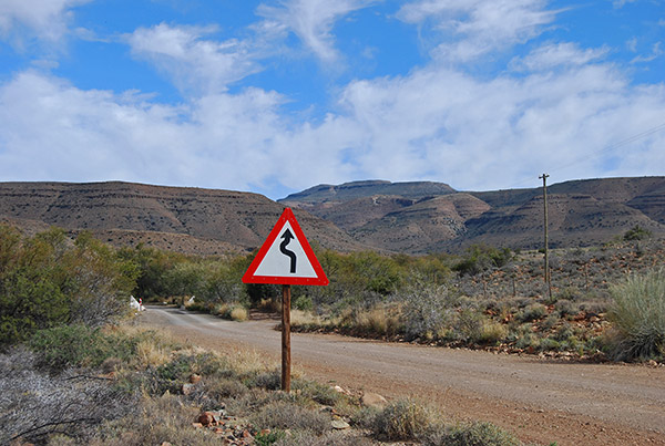 The western Nuweveld Mountains loom above the road linking Merweville and Sutherland