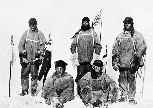 Captain Oates (standing on right) pictured at the South Pole with Robert Falcon Scott