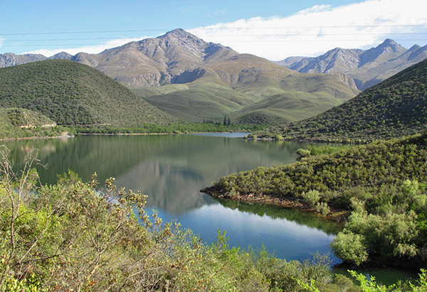 Koos Raubenheimer Dam lies in the shadow of the Swartberg Mountains